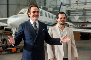 TI_D009_LD_00285_R_CROP (l to r) Bryan Cranston stars as undercover U.S. Customs agent Robert Mazur and John Leguizamo as his partner Emir Abreu in THE INFILTRATOR, a Broad Green Pictures release. Credit: Liam Daniel / Broad Green Pictures